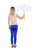 Back view woman showing sign board. Stock Image