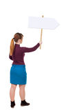 Back view woman showing sign board. Stock Images