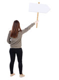 Back view woman showing sign board. Stock Photography