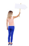Back view woman showing sign board. Royalty Free Stock Photo