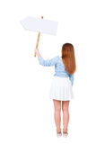 Back view  of woman showing a sign board. Stock Image