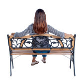 Back view of a woman sitting on  bench Stock Photos