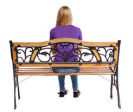 Back view of a woman sitting on  bench Royalty Free Stock Photos
