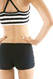 Back view of a woman with a slender waist on white background Royalty Free Stock Image