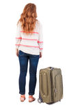 Back view woman with suitcase looking up Stock Photos
