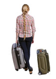 Back view of woman with suitcase looking up. Standing young girl. Royalty Free Stock Images
