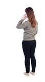 Back view of a woman talking on the phone.  backside view of per Royalty Free Stock Photography