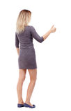 Back view of  woman thumbs up Stock Images