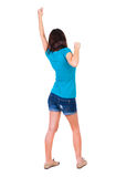 Back view of  woman thumbs up. Rear view people collection. backside view of person. Isolated over white background. slender brunette in a jeans shows the Stock Image