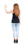 Back view of woman thumbs up. Rear view people collection. backside view of person. Isolated over white background. slender redhead in a jeans shows the symbol royalty free stock images