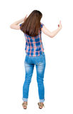 Back view of  woman thumbs up. Stock Image
