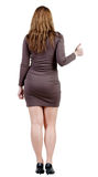 Back view of woman thumbs up. rear view. Stock Photos