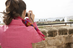 Back View of Woman Using Photo Camera Royalty Free Stock Photography