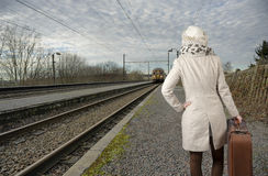Back view of woman wating for her train Stock Photo