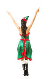 Back view of woman wearing elf clothes pointing up with both hands Stock Photography