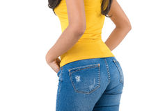 Back view of woman wearing jeans and yellow t-shirt, middle part Stock Photos