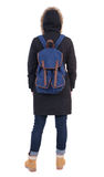 Back view woman in winter jacket  with a backpack looking up Stock Images