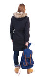Back view woman in winter jacket with  backpack Royalty Free Stock Photo