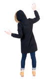 Back view woman in winter jacket  Balances waving his arms. Royalty Free Stock Photography