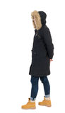 Back view woman in winter jacket  looking up Royalty Free Stock Images
