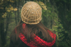 Back view of woman with wool cap and scarf royalty free stock photos