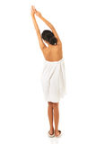 Back view woman wrapped in towel with arms crossed Stock Images