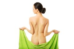 Back view woman wrapped in towel showing her bum Royalty Free Stock Photo