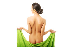 Back view woman wrapped in towel showing her bum Royalty Free Stock Images