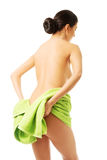 Back view woman wrapped in towel showing her bum Royalty Free Stock Image