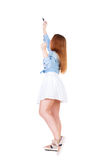 Back view of writing beautiful redhead woman. Young girl in dres Royalty Free Stock Photos