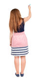 Back view of writing beautiful redhead woman. Stock Photo