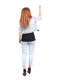 Back view of writing beautiful redhead woman. Royalty Free Stock Photography