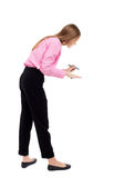 Back view of writing beautiful woman Stock Image