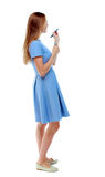 Back view of writing beautiful woman. Young girl in dress. Stock Photography