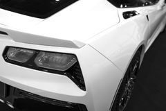 The back view of a yellow luxury sport car. Exhaust system. Modern Sport Car exterior details. Black and white.  royalty free stock photos