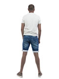 Back view of young african american in shorts looking. Royalty Free Stock Photography