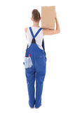 Back view of young attractive woman in blue coveralls with cardb Stock Image