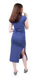 Back view of young beautiful girl standing in thoughtful pose. Royalty Free Stock Image