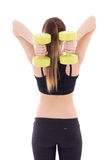 Back view of young beautiful slim woman with dumbbells isolated Stock Image
