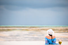 Back view of young beautiful woman on the beach during low tide Royalty Free Stock Photography