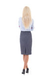Back view of young beautiful woman in business suit isolated on Royalty Free Stock Photography