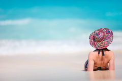 Young woman relaxing at beach Stock Image