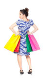 Back view of young beautiful woman with shopping bags looking at Stock Images