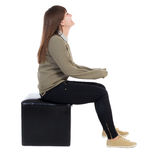 Back view of young beautiful  woman sitting.  girl  watching Stock Image