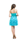 Back view of young beautiful woman in turquoise cocktail dress. Isolated on white background Royalty Free Stock Photos