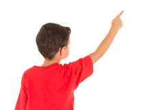 Back view of a young boy pointing his finger Royalty Free Stock Photo