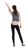 Back view of young brunette woman pointing Royalty Free Stock Photos