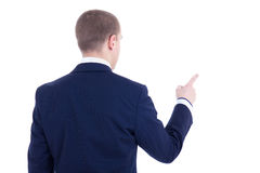 Back view of young business man pointing at something isolated o Stock Photos