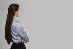 Back view of young business woman looking at copy space Royalty Free Stock Photography
