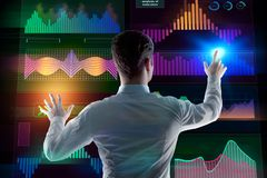 Innovation, future and finance concept. Back view of young businessman managing business screen. Innovation, future and finance concept. 3D Rendering Stock Images
